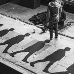 Paper cutouts of man walking